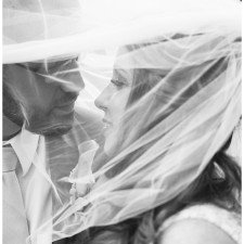 bride and groom under veil black and white