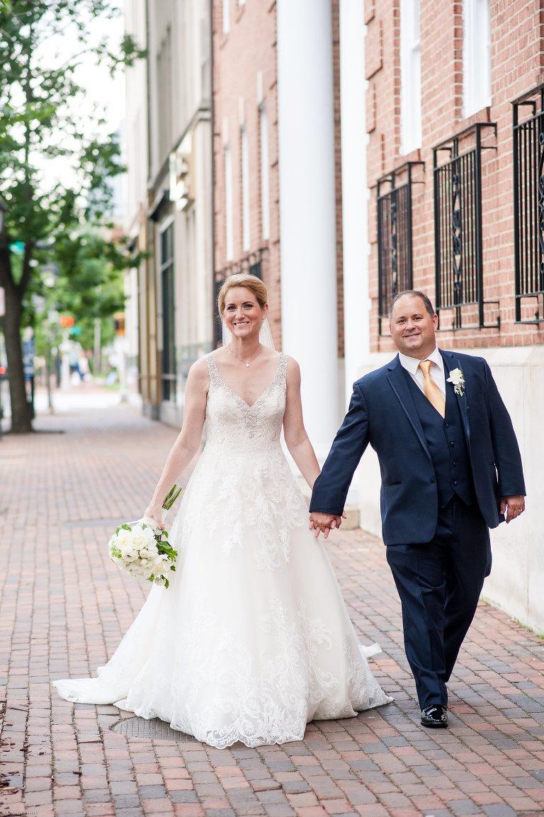 Old town Alexandria wedding pictures walking on sidewalk outside of Washington street united methodist church
