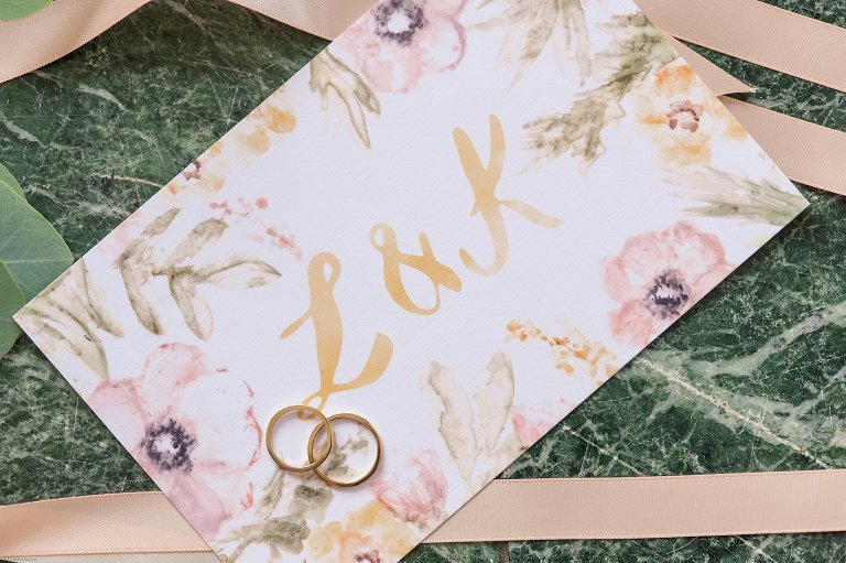 Wedding invitation and rings Fauquier Springs Country Club Wedding Amber Kay Photography