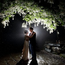 Bride and groom night time silhouette picture under white flowering tree in the rain Thorpewood Mountain Memories wedding Thurmont, MD